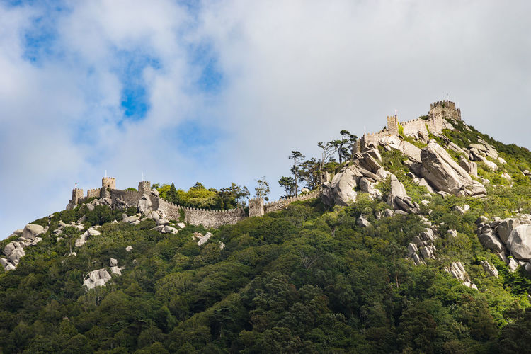 Castle of the moors on mountain against sky