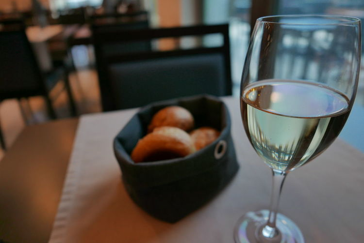 Close-up of wine in glass on table at restaurant