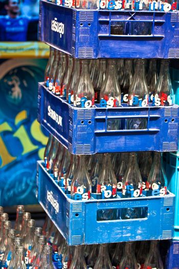 Empty Bottles Glass Bottles Bottle Stacks Bottle Boxes Streetphotography Street Scene Glass Blue And Red