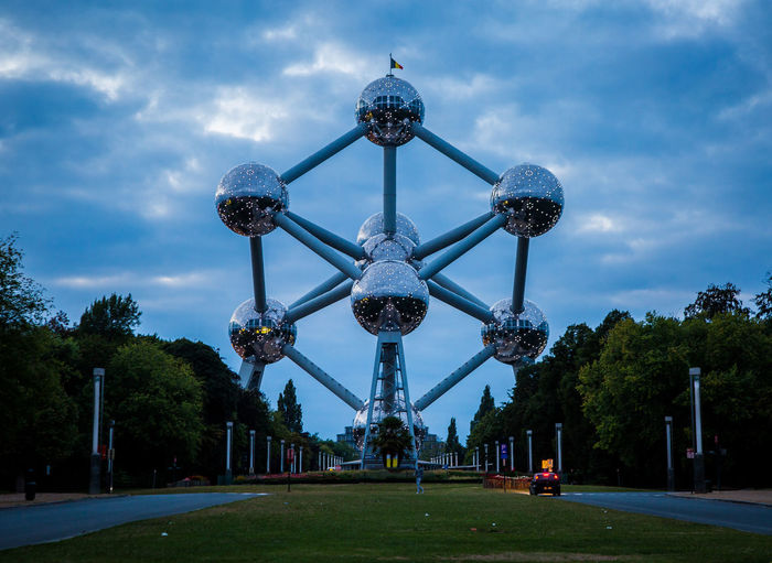 The Atomium in Brussels at dusk Atomium Brussels Architecture Atomium Blue Building Exterior Built Structure City Cloud - Sky Day Dusk Grass Incidental People Nature Outdoors Park Plant Sky Tall - High Tourism Travel Travel Destinations Tree