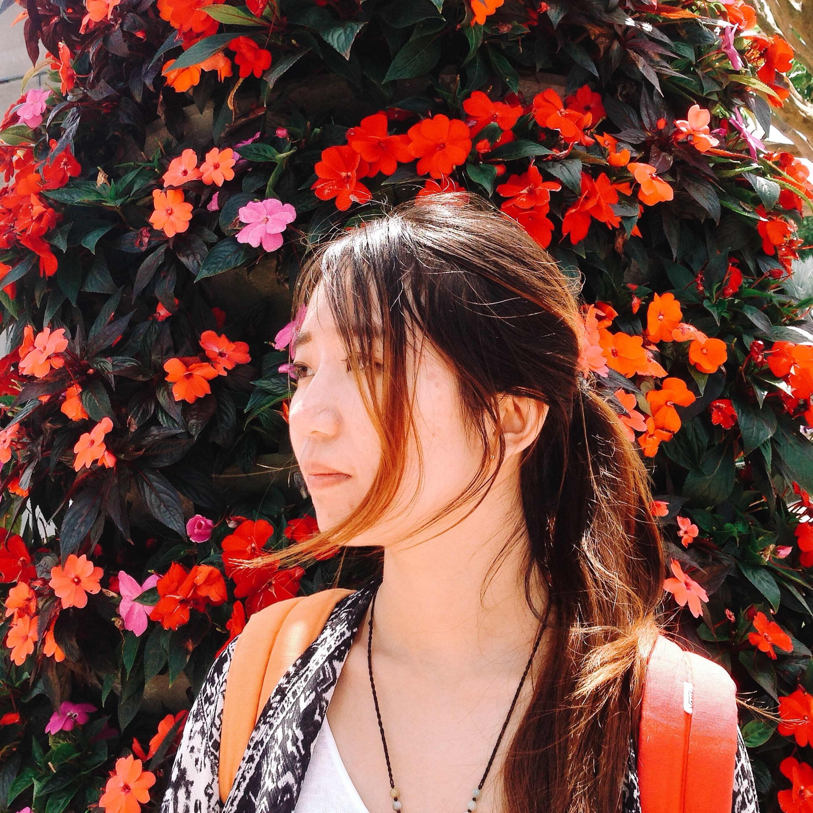 young adult, young women, person, long hair, lifestyles, leisure activity, looking at camera, headshot, portrait, casual clothing, front view, smiling, red, flower, brown hair, close-up, blond hair