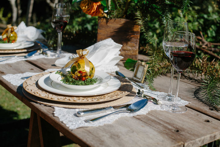 Place setting with wine glasses on table