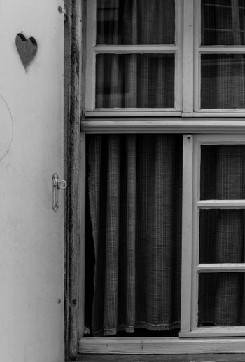 Random Love. Blackandwhite Photography Closed Window Built Structure Architecture_collection Colmar, Alsace, France Colmar Black & White France Vive La France Black And White Blackandwhite Love Random Random Love Travel Photography Traveling Travel Travel Destinations Windows Heart Architecture Outdoors Building Exterior Close-up