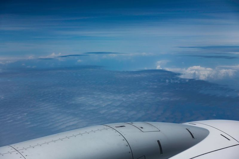 On a flight Air Vehicle Airplane Transportation Flying Mode Of Transportation Sky It's About The Journey Cloud - Sky Travel Nature Engine Aerial View Jet Engine Aircraft Wing Outdoors Blue Commercial Airplane No People Beauty In Nature Scenics - Nature High Angle View