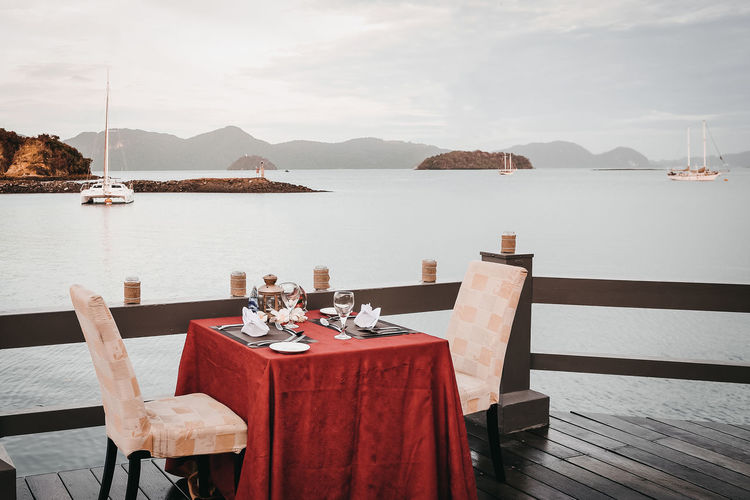 Holiday Modern Hospitality Sunset Dinner Beauty In Nature Honeymoon Honeymooners Idyllic Langkawi Island Luxury Peaceful Evening Romantic Dinner Scenics - Nature Sea Sky Table For Two Tranquility