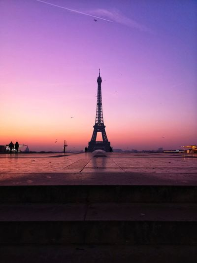 Silhouette eiffel tower against sky during sunset