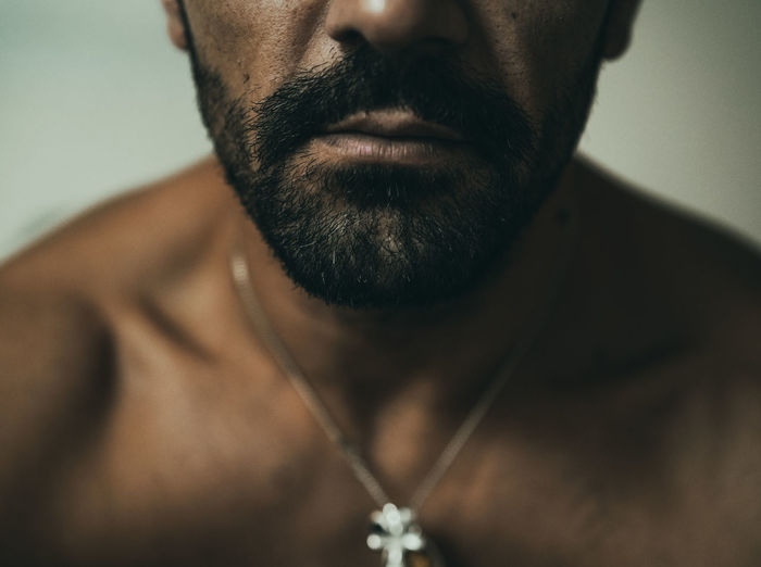 Close-up portrait of shirtless man
