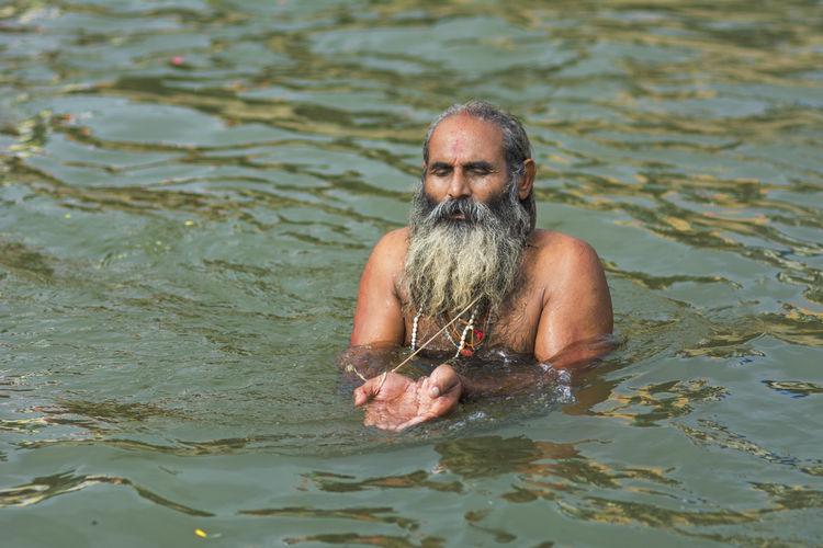At nashik kumbhmela. Beard Godavari Holy India Kumbhmela Nashik Portrait Praying River Sadhu Sage Showcase: December Surya Namaskar Water TCPM