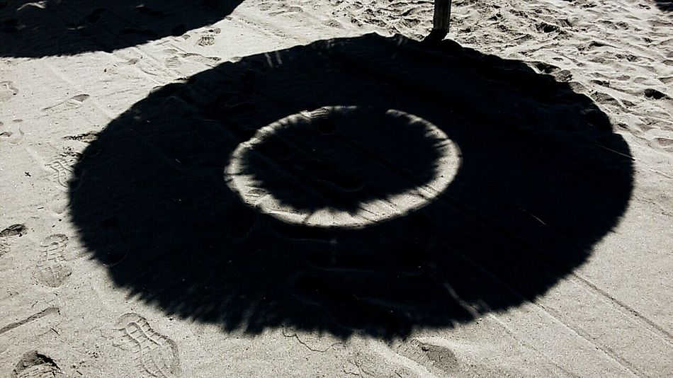 Shadow BYOPaper! Welcome To Black Pivotal Idea Shadow On Sand Imprint On Sand Circles Pattern Beach Umbrella Footprints I See Black And White Outside Photography Lights And Reflections Shadow Of Our Soul Shotting Out Golden Hour Filmphoto EyeEm Selects Art Photography EyeEmNewHere Be. Ready. No People Summer Exploratorium Visual Creativity 10 Focus On Shadow Geometric Shape Sandy Beach Circular