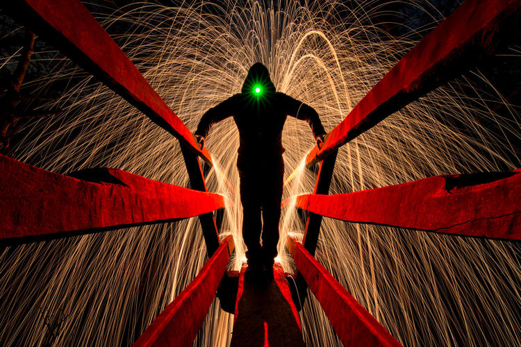 Illuminated Night Motion Red Standing Real People Indoors  One Person Rear View Pattern Celebration Design Leisure Activity Lifestyles Glowing Men Speed Blurred Motion Digital Composite