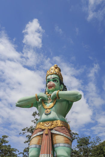 Low angle view of hanuman statue against sky
