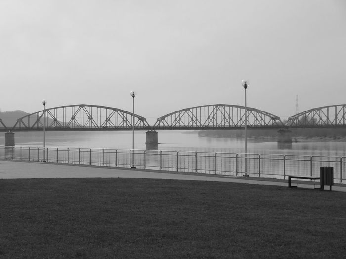 Bridge - Man Made Structure Bridge Bridge View Bridge Photography Blackandwhite Black And White Black & White Blackandwhite Photography Black And White Photography Black&white River View Vistula River Vistula VistulaRiver Grudziądz Poland Perspective River Betterlandscapes Welcome To Black The Great Outdoors - 2017 EyeEm Awards Built Structure Architecture Water Building Exterior No People Transportation Outdoors Steel Sky