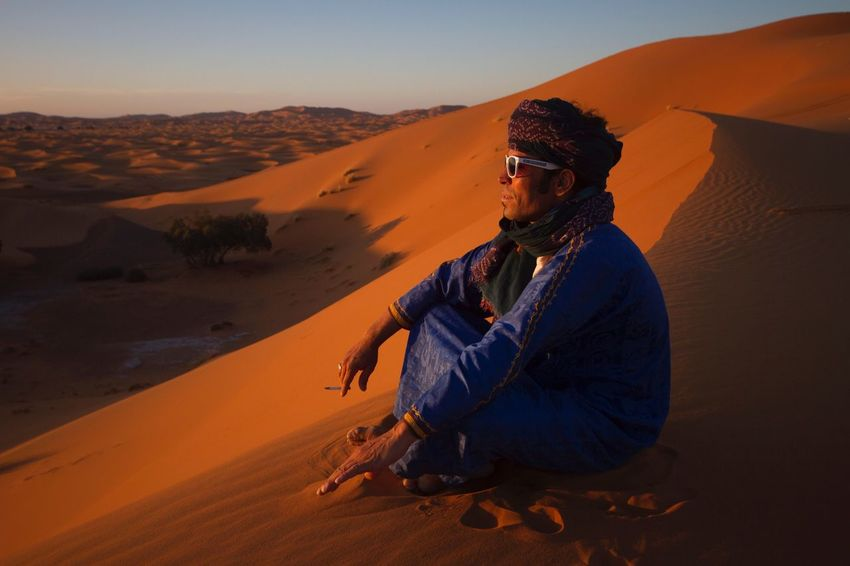 Hanging out in the desert | Desert Sand Dune Sitting Real People Nature Outdoors Sunset Adventure Sahara Landscape Scenics Beauty In Nature Lifestyles