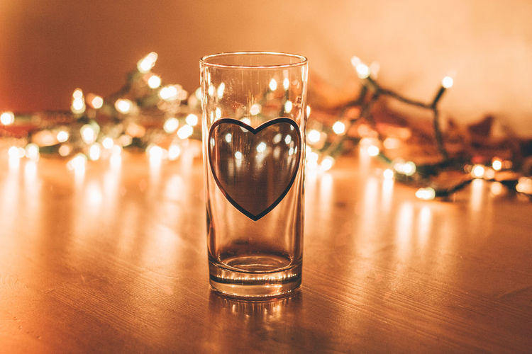 Light and Love Blur Bokeh Burning Celebration Celebration Christmas Christmas Christmas Lights Christmas Ornament Close-up Defocused Depth Of Field Drink Focus On Foreground Glass Illuminated Indoors  Light Night No People Refraction Shiny Table
