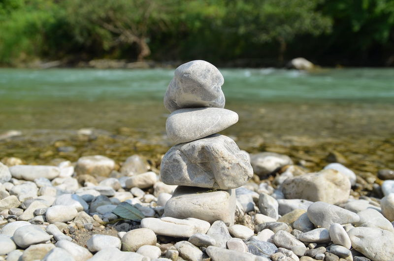 Stack of stones against river