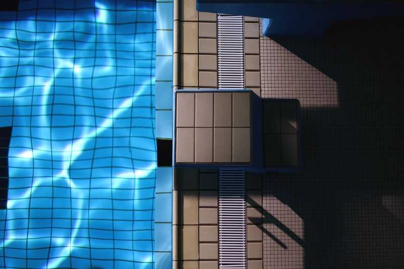 Reflection of building on swimming pool