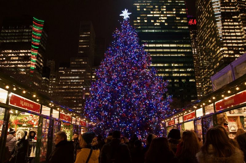 Bryant Park NYC Architecture Building Exterior Built Structure Celebration Christmas Christmas Decoration Christmas Lights christmas tree City Crowd Illuminated Large Group Of People Night Outdoors People Real People Tree