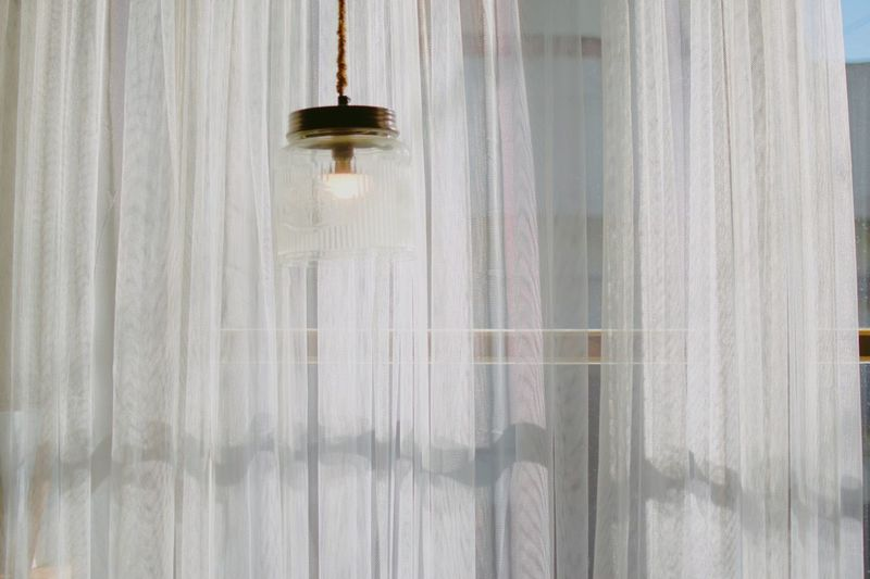 Sunshine Inspirations Light Sunshine Curtain Hanging Indoors  Window Low Angle View Drapes  No People Home Interior Day