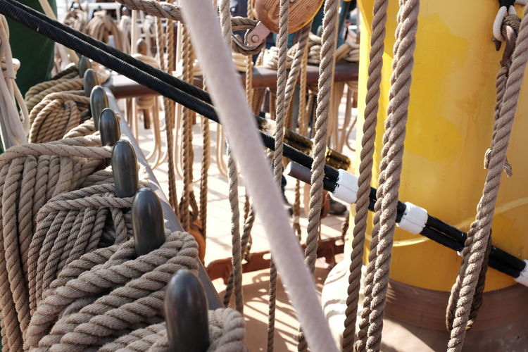High angle view of ropes tied up to metal railing