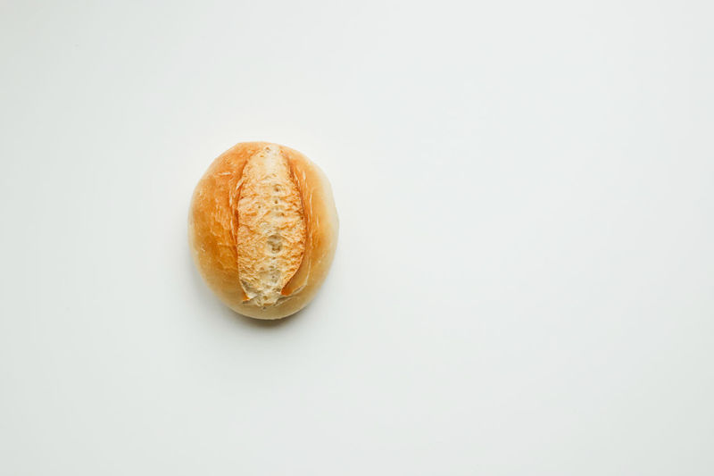 High angle view of bread on white background