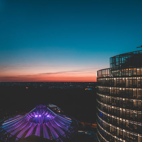 Berlin Architecture Blue Building Building Exterior Built Structure City Cityscape Clear Sky Copy Space Dusk High Angle View Illuminated Nature Night No People Office Building Exterior Outdoors Sky Skyscraper Sunset Theatre Travel Destinations Water