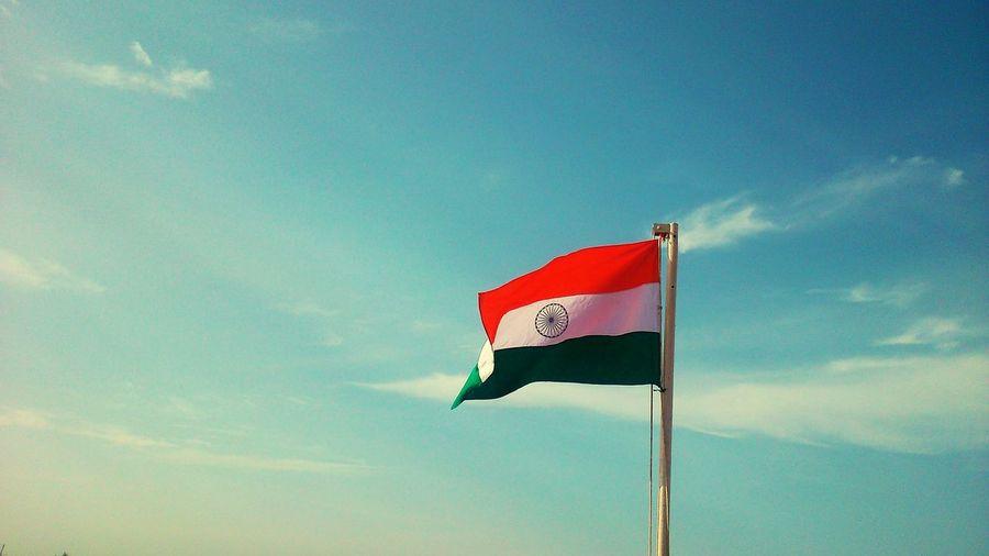 Indian flag against blue sky