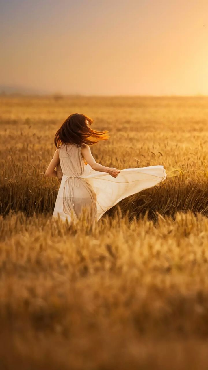 sunset, one person, field, nature, grass, one woman only, young adult, sky, women, outdoors, only women, beauty in nature, landscape, full length, wheat, adult, one young woman only, young women, day, adults only, people
