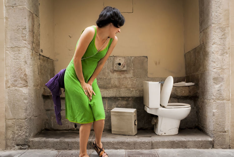 to pee or not to pee... Wc Barcelona Concept Green Street Urban Urban Scene One Person Casual Clothing Young Adult Clear Sky Scene Moments Of Life Funny Moments Difficult Confused Strange Hurry Peeing Choosing Summertime Stressed