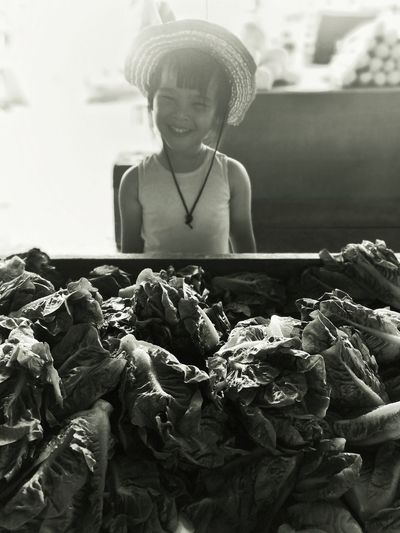 Cowgirl in the market EyeEmNewHere The Week on EyeEm Girl Cowgirl Black & White Blackandwhite Black And White Sihouette  Child Agriculture Smiling Human Hand Childhood Happiness Vegetable Harvesting The Portraitist - 2018 EyeEm Awards