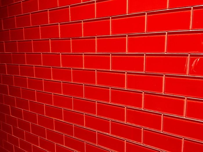 Bright red glass tiles. I liked them. Red Full Frame Brick Wall Backgrounds Textured  Repetition No People Architecture Built Structure Close-up Exploring Color Photography Tiles Glass Glass - Material Glass Art Organization Linear Perspective Showcase April This Week On Eyeem Things I Like Check This Out Brilliant Color