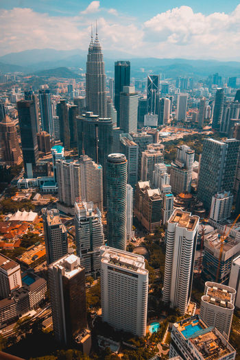What a overcrowd city! City Cityscape Architecture Building Skyscraper Sky Modern Urban Skyline Tower Landscape City Life Office High Angle View KLCC Twin Towers KL Tower View Orange And Teal Tallest City Street Street Malaysia Maxis Tower Maybank Kuala Lumpur