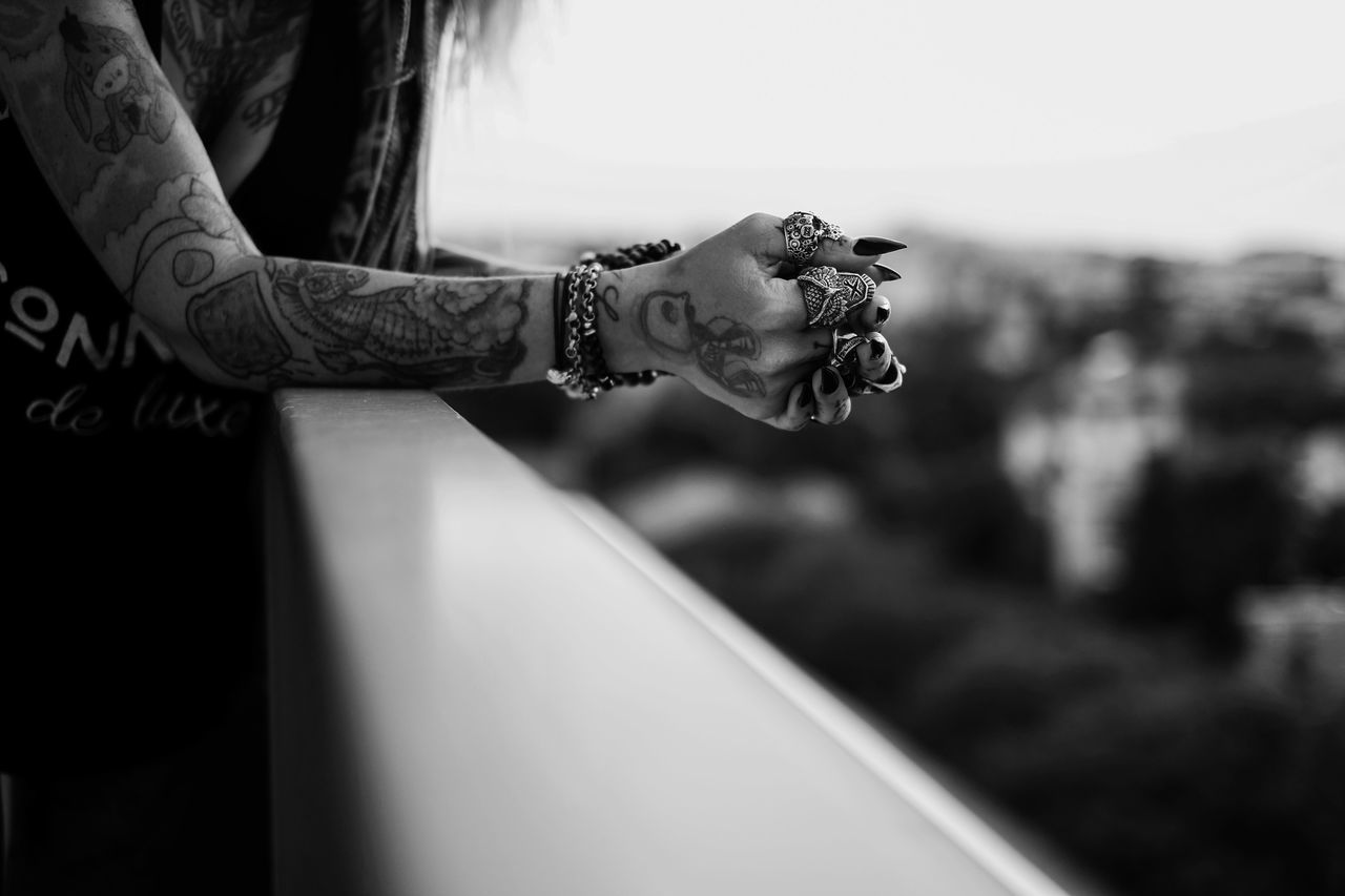 lifestyles, one person, focus on foreground, real people, tattoo