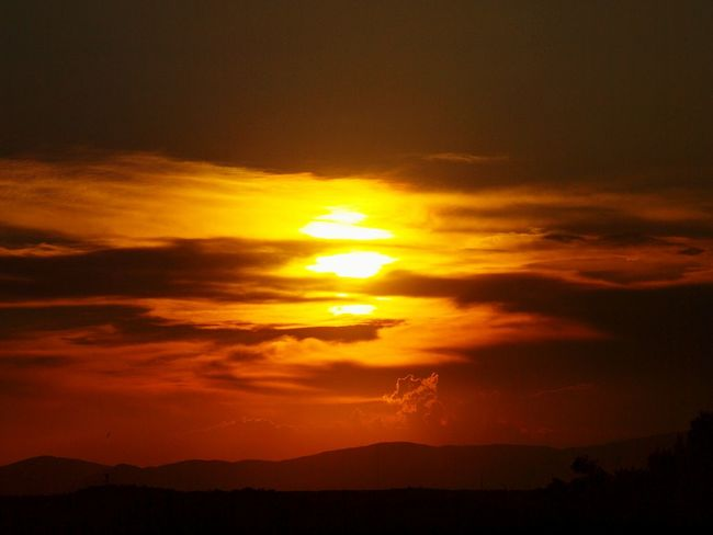 Sunset Dramatic Sky Beauty In Nature Nature Scenics Silhouette Sun No People Outdoors Yellow Sky Tranquility Cloud - Sky Landscape Mountain Day