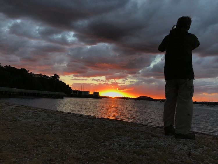 Sunset Twilight Taking Pictures Sunset Cloud - Sky Silhouette Sky One Person Standing Water Nature Real People Beauty In Nature Scenics Leisure Activity Men Outdoors Tranquil Scene Horizon Over Water One Man Only