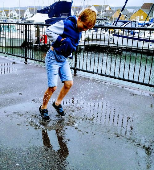 Water Wet Childhood Casual Clothing Playing Day One Person Motion Real People Outdoors Puddle Splashing Splash Blue Children Joy Fun Play Rainy Days