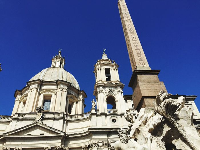 Low Angle View Of Fontana Dei Quattro Fiumi Against Sant Agnese In Agone