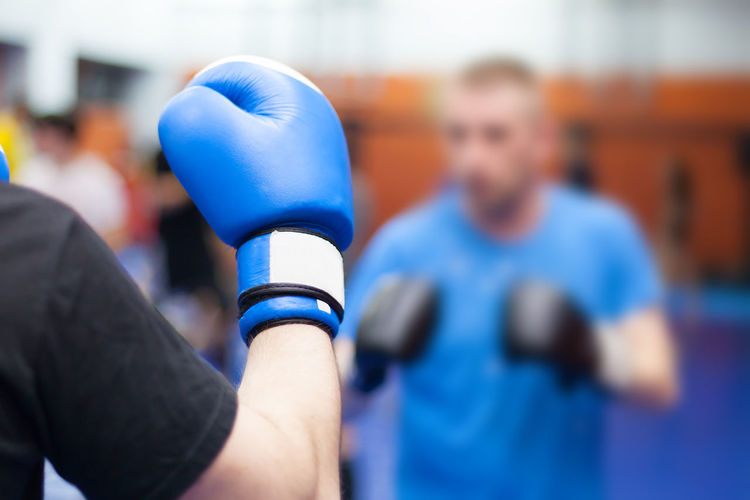 Close-Up Of Man Wearing Boxing Glove