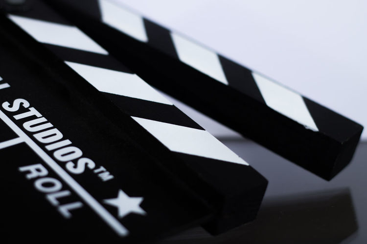 Capital Letter Clapper Clapper Board Close-up Communication Creativity Decoration Differential Focus Ideas No People Selective Focus Studio Shot Text Western Script White Background