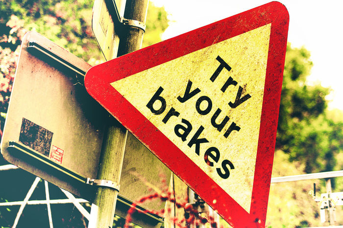 Life too fast?? Try your brakes! Relax..chill out.... smile and be happy. :-) Auto Brakes Chill Chillin Choice Close-up Communication Day Life Lifestyle Lifestyle Photography Lifestyles Low Angle View Message No People Outdoors Red Relax Road Sign Test Testing Text Warning Warning Sign Warning Signs