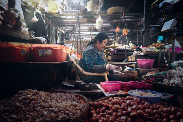 Costermonger at Work (Pyin Oo Lwin, Myanmar) Agriculture Burma Choice Costermonger Light And Shadow Market Market Market Stall Morning Market Myanmar Pyin Oo Lwin Small Business Streetphotography Vegetables