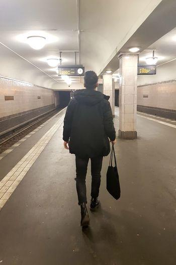 Exploring Berlin Exploring Black Dressed Arriving Stairs Architecture Urban City Full Length Men Subway Subway Platform Underpass Ceiling Light  Underground Underground Walkway Subway Station Subway Train Passenger