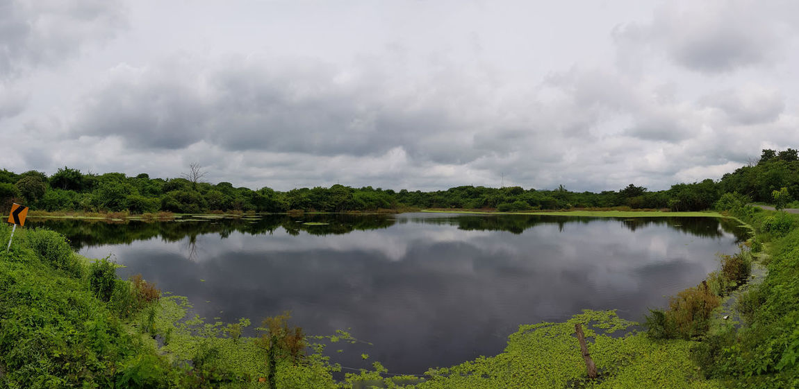 Beauty In Nature Ciénaga Cloud - Sky Day Galapa Lagoon Lake Nature No People Outdoors Reflection Scenics Sky Tranquility Tree Water