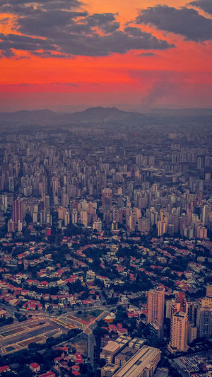 Aerial view of modern buildings in city during dusk