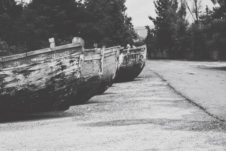 View of abandoned boat on riverbank