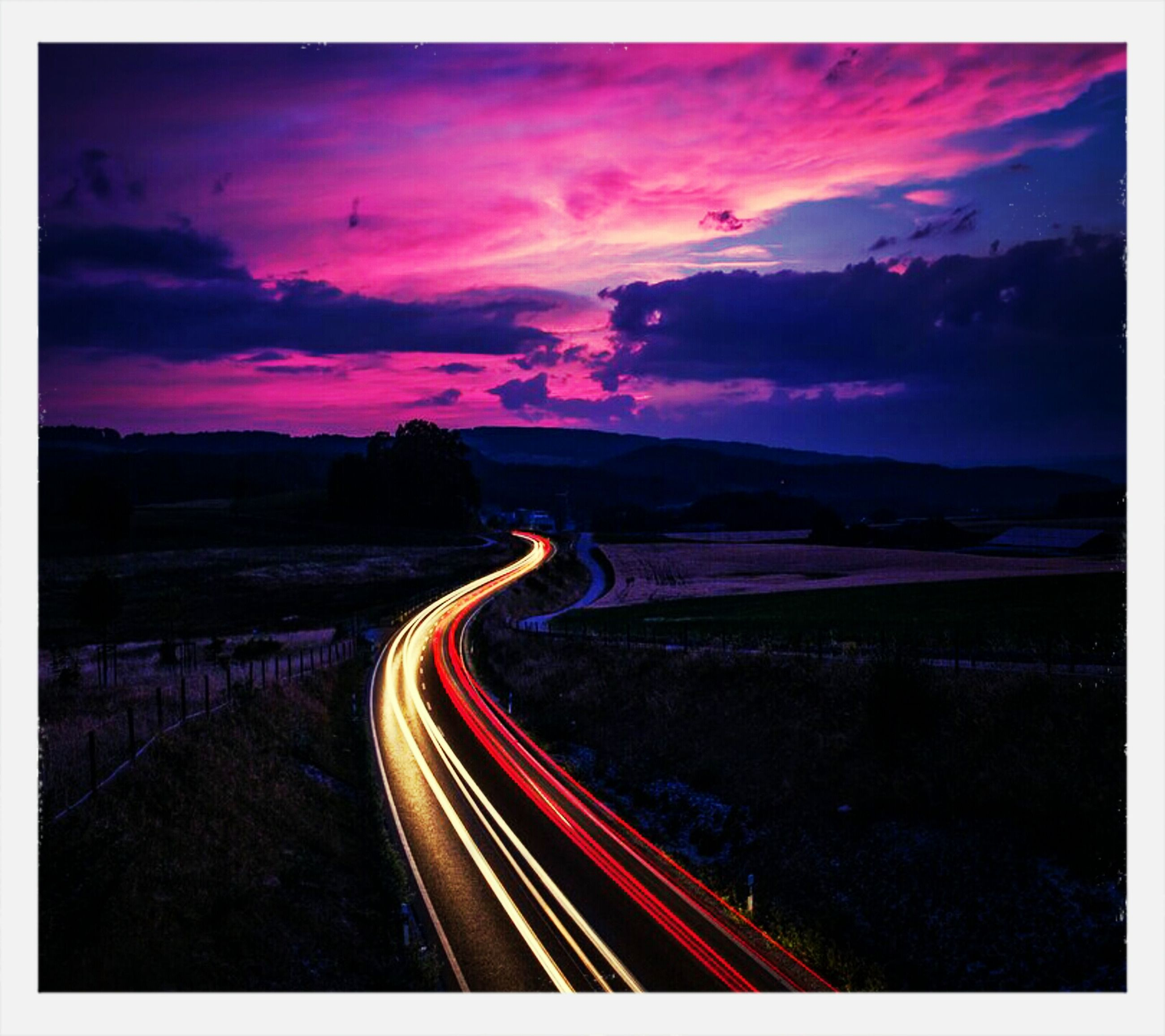 illuminated, light trail, long exposure, night, sky, transportation, road, speed, motion, blurred motion, auto post production filter, transfer print, dusk, multi colored, the way forward, red, street, outdoors, cloud - sky, no people