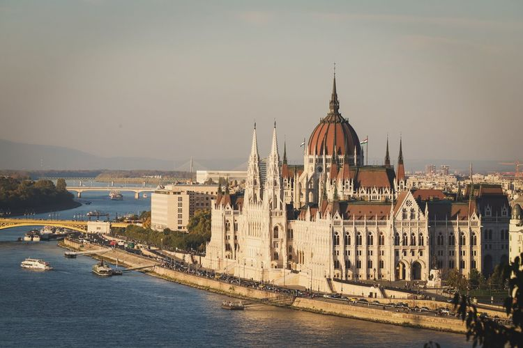 Hungarian parliament building by danube river in city