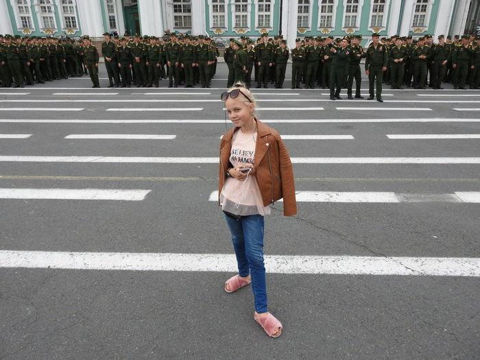 Portrait of smiling girl standing on city street