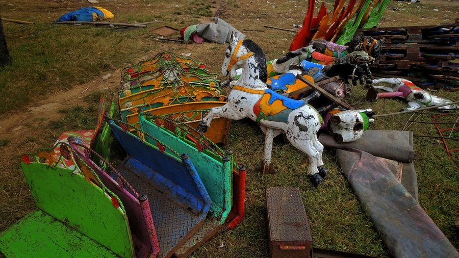 Old Carousel Horses On Field