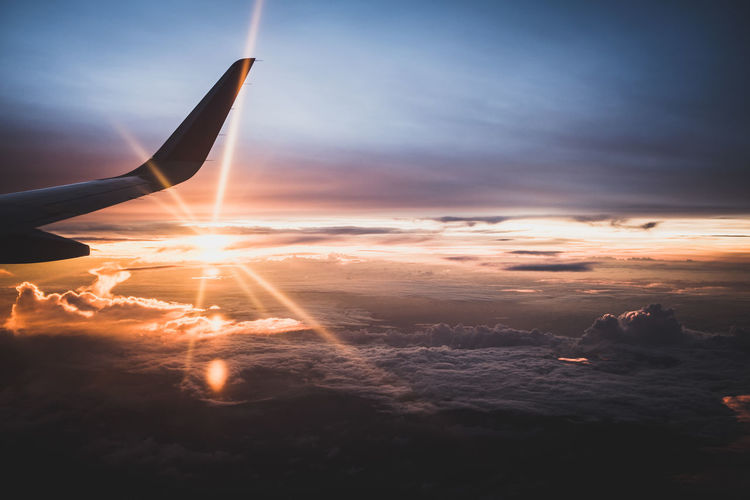 The Traveler - 2018 EyeEm Awards Air Vehicle Aircraft Wing Airplane Beauty In Nature Bright Cloud - Sky Flying Lens Flare Mode Of Transportation Nature No People Orange Color Outdoors Plane Scenics - Nature Sky Sun Sunbeam Sunlight Sunset Transportation Travel
