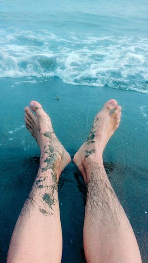 All loose things seem to drift down to the sea, and so did I. Louis L'Amour Relaxation Low Section Person Personal Perspective Barefoot Human Foot Water Sand Beach Leisure Activity Lifestyles Legs Crossed At Ankle Rippled Resting Sea Limb Ocean Vacations Individuality Human Skin